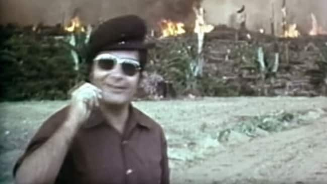 Jim Jones in trademark sunglasses as land is cleared in Guyana for his so-called utopian commune.
