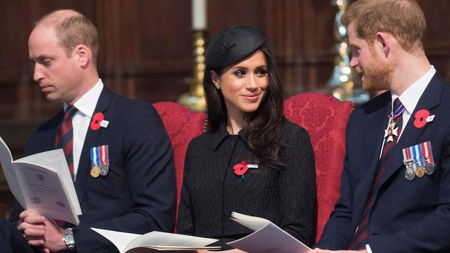 Prince William looked exhausted as he sat alongside Meghan Markle and his brother. Picture: AFP Photo/Pool/Eddie Mulholland