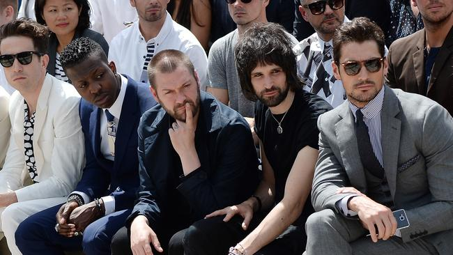 Nick Grimshaw, Jamal Edwards, Tom Meighan, Serge Pizzorno and David Gandy sit in the front row at Burberry Menswear show in London. Picture: Samir Hussein / Getty Images