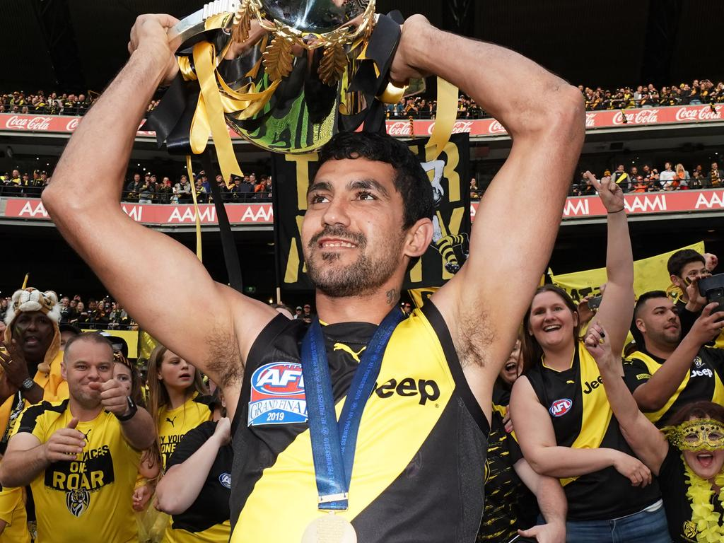 Marlion Pickett of the Tigers celebrates the win with the Premiership Cup during the 2019 AFL Grand Final between the Richmond Tigers and the GWS Giants at the MCG in Melbourne, Saturday, September 28, 2019. (AAP Image/Michael Dodge) NO ARCHIVING
