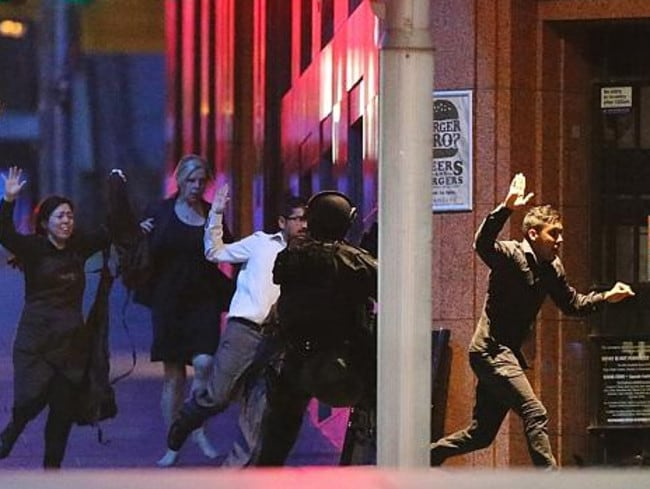 Viswakanth Ankireddy, third from left, runs for safety with a group of hostages, including Harriette Denny.