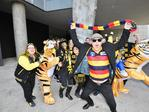 A Crows fan crashes a Tigers supporters' photo as fans stream into MCG. Picture: Jason Edwards