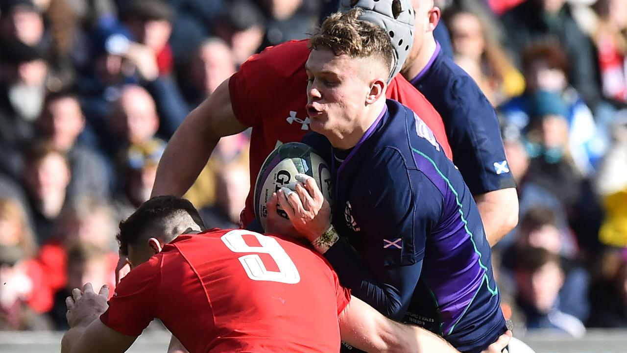 Wales' scrum-half Gareth Davies (L) tackles Scotland's wing Darcy Graham during the Six Nations international rugby union match.