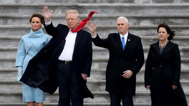 First Lady Melania Trump, President Donald Trump, Vice President Mike Pence and Karen Pence wave goodbye to Barack and Michelle Obama on the West Front of the US Capitol. Picture: Getty