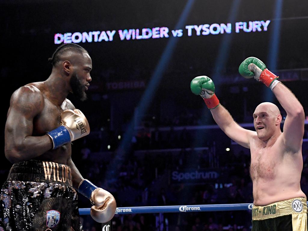 Tyson Fury baits Deontay Wilder during their first fight.