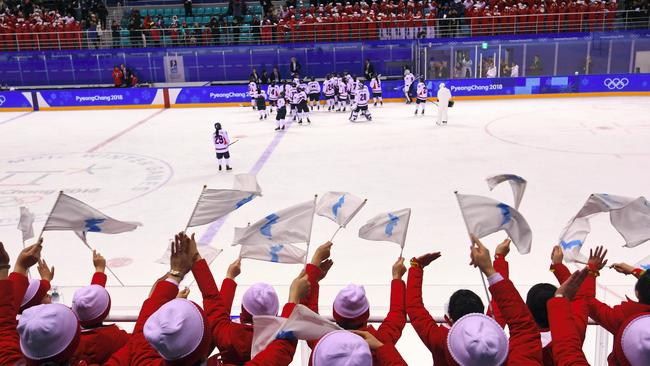 North Korea's cheerleaders wave the Unified Korea flag and cheer for the Unified Korea team players. Picture: AFP/ Jung Yeon-je.