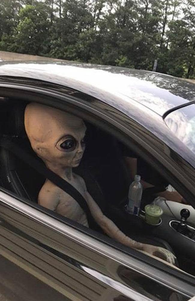Oxford researchers say alien life will face many of the same challenges we do ... Here, an 'alien' figure sits in the passenger seat of a vehicle that was pulled over for a safety check north of Atlanta, Georgia. Picture: Alpharetta Department of Public Safety via AP