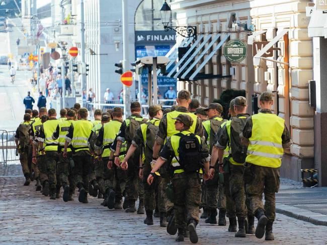 Military and police personnel are patrolling area of the Finnish Presidential palace in Helsinki ahead of the meeting between US President and his Russian counterpart. Picture: Alessandro Rampazzo/AFP Photo