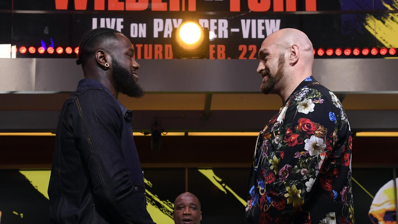 Deontay Wilder (L) and Tyson Fury face off.