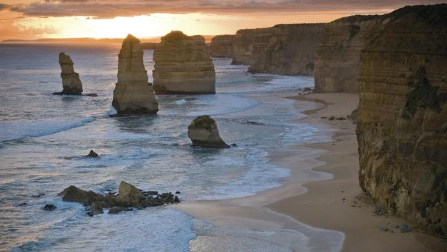 The Twelve Apostles at sunset. Soon, hundreds of little penguins will make their way ashore here, giving visitors on the lookout above the beach a commanding view of the penguin parade. Picture: Parks Victoria