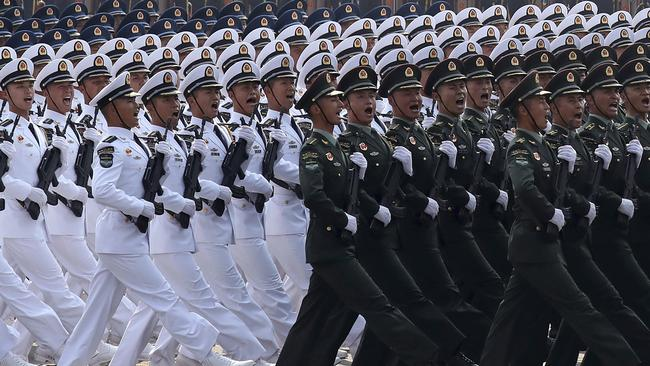 Some noticed the troops all appeared to be the same height. Picture: Ng Han Guan/AP