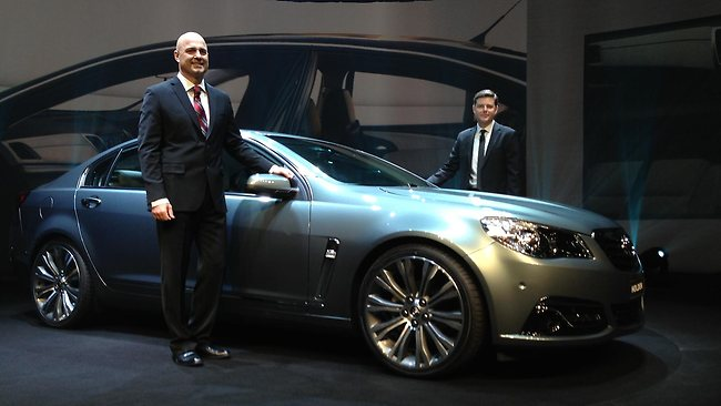 Holden boss Mike Devereux and design chief Andrew Smith unveil the VF Commodore. Picture: Joshua Dowling