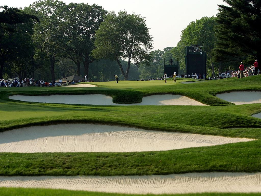 MAMARONECK, NY - JUNE 18: A general view of the 12th hole as Phil Mickelson putts on the green during the final round of the 2006 US Open Championship at Winged Foot Golf Club on June 18, 2006 in Mamaroneck, New York. (Photo by Ezra Shaw/Getty Images)