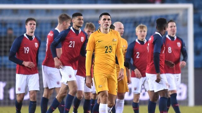 Tom Rogic of Australia looks on