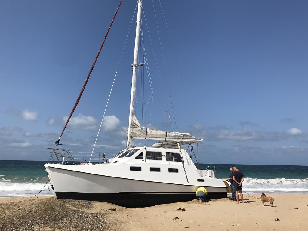 Catamaran runs aground on North Entrance Beach | News Local