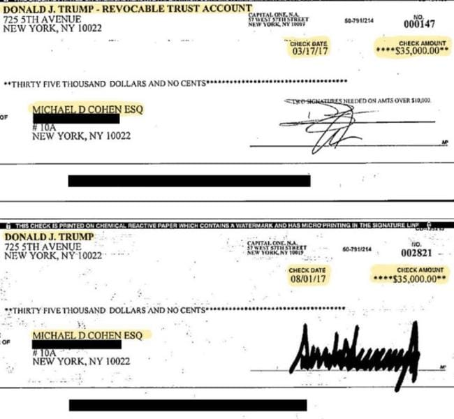 The two cheques. That is Donald Trump's signature down the bottom.