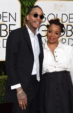 Wiz Khalifa and Peachie Wimbush arrive at the 73rd annual Golden Globe Awards, January 10, 2016, at the Beverly Hilton Hotel in Beverly Hills, California. Picture: AFP PHOTO / VALERIE MACON