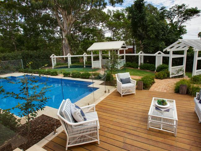 The home is set on 1027 sqm with pool and landscaped gardens.