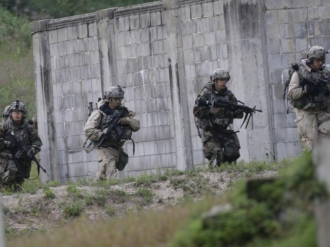 US Army soldiers from the 2nd Infantry Division's the 2nd Armored Brigade Combat Team move during a joint military exercise between the US and South Korea. Picture: AP