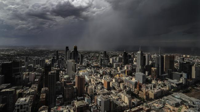 A storm rolls into Melbourne after a very hot day, as viewed from Eureka Skydeck. Picture: Alex Coppel