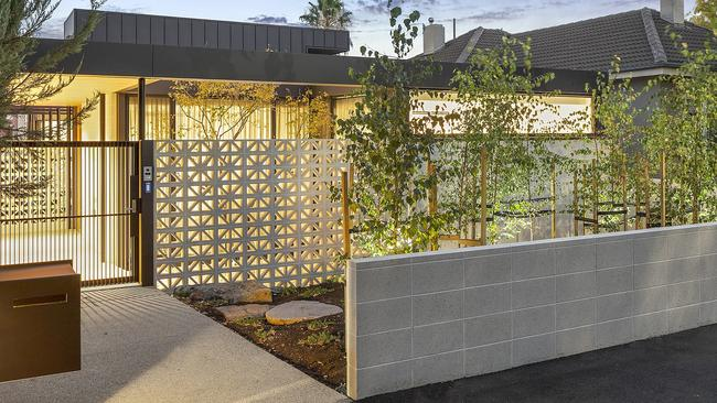 While the new home's facade is understated, it still has design flourishes, such as breezeblocks.