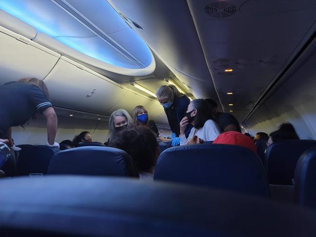 Passengers jumped in to help as a man began to die from COVID-19 on the United Airlines flight. TMZ/Backgrid