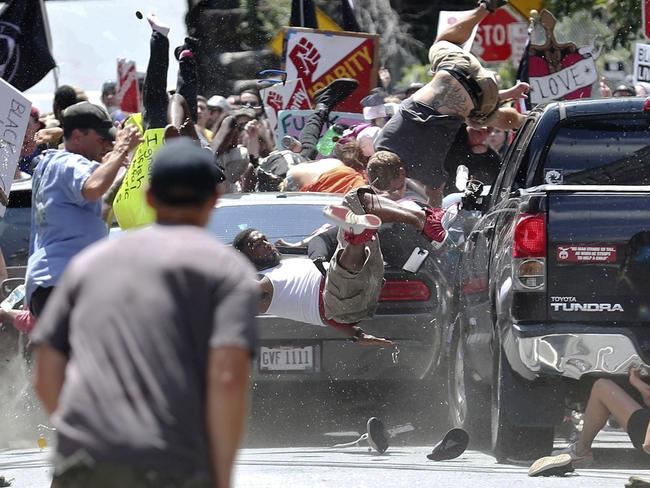 The world watched in horror as a car ploughed into a crowd of protesters demonstrating against a white nationalist rally in Charlottesville on August 12 last year. Picture: Ryan M. Kelly/The Daily Progress via AP, File