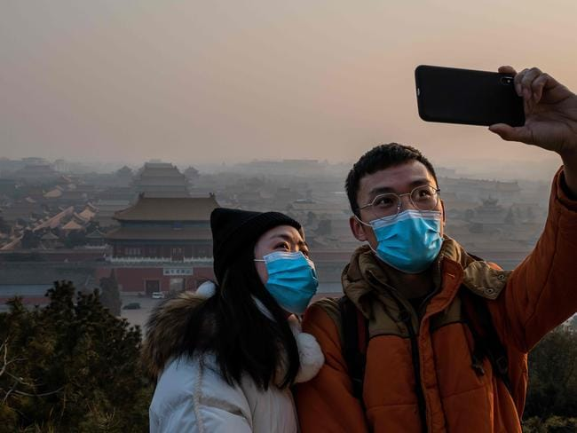 A selfie with a difference at the Forbidden City in Beijing. Picture: NICOLAS ASFOURI / AFP)