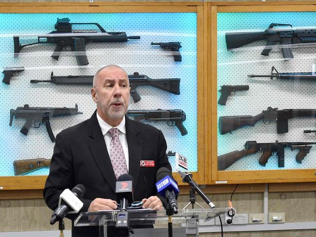 """Detective Chief Inspector Wayne Hoffman of the NSW Police addresses the media in August in front of a cabinet full of guns previously seized from criminals. Picture: Peter Parks / AFP  <a capiid=""""5a9b2ce8d756ef710f3f202bff1658b0"""" class=""""capi-video"""">Cost saving courts</a>"""