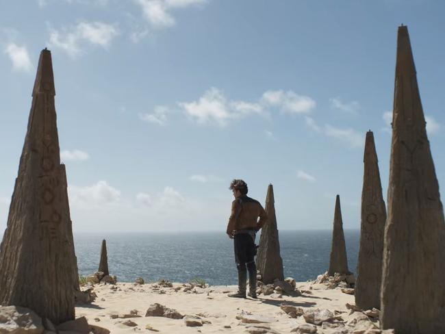 Han Solo makes a decision while among ancient, engraved standing stones. Picture: Solo: A Star Wars Story.