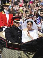 Britain's Prince Harry, Duke of Sussex and his wife Meghan Markle, the Duchess of Sussex travel in the Ascot Landau carriage during a carriage procession after their wedding ceremony at St. George's Chapel in Windsor Castle, in Windsor, near London, England, Saturday, May 19, 2018. Credit: Christopher Furlong/pool photo via AP