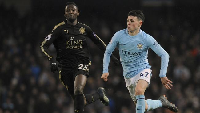 Manchester City's Phil Foden, right, challenges for the ball with Leicester's Wilfred Ndidi
