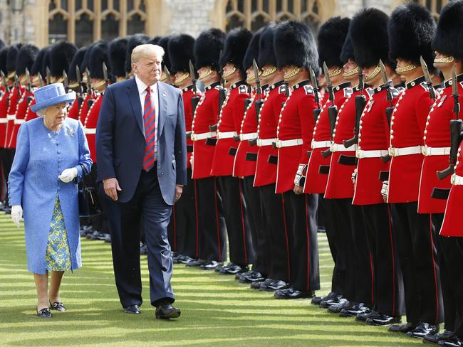 The Queen and US President Donald Trump inspect the Guard of Honour before watching the military march past at Windsor Castle. Picture: Mega