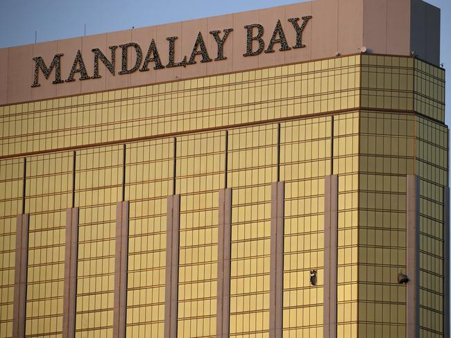 Drapes billow out of broken windows at the Mandalay Bay resort and casino on the Las Vegas Strip. Picture: AP