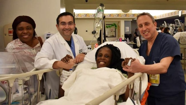 This picture, released by the Woman's Hospital of Texas, shows Thelma Chiaka with medics.