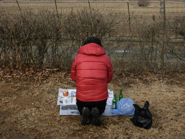 A woman pays her respects to relatives and ancestors from North Korea near the Demilitarised Zone (DMZ) separating North and South Korea. Picture: AFP