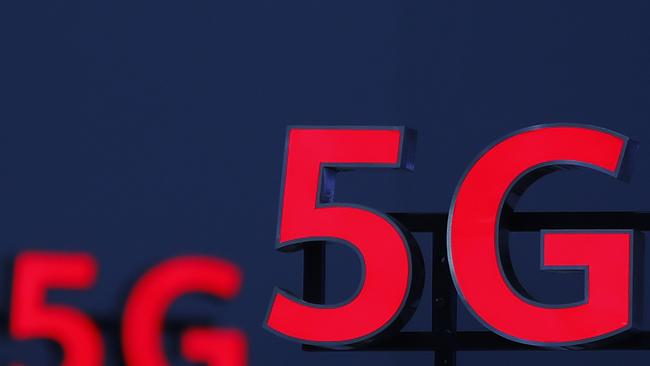 Telstra and Optus have begun rolling out their 5G networks. Vodafone is waiting for a decision on whether it can merge with TPG, which claims to have abandoned its 5G build after the Huawei ban. Picture: Stefan Wermuth / AFP