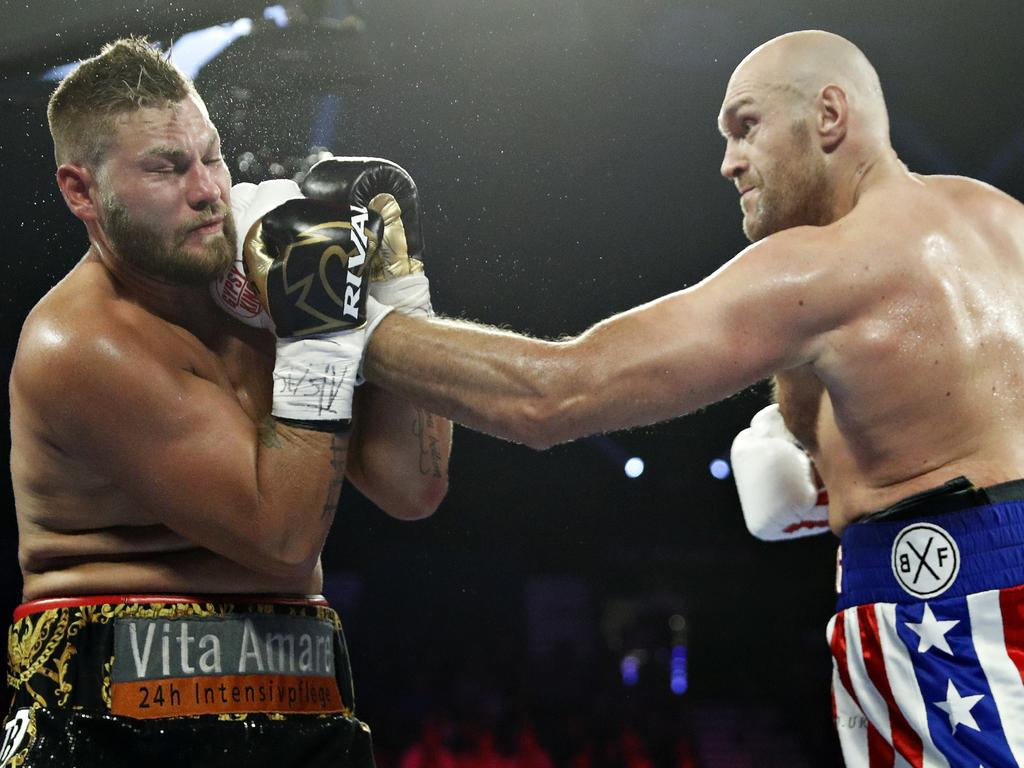 Tyson Fury, of England, lands a left to Tom Schwarz, of Germany, during a heavyweight boxing match Saturday, June 15, 2019, in Las Vegas. (AP Photo/John Locher)