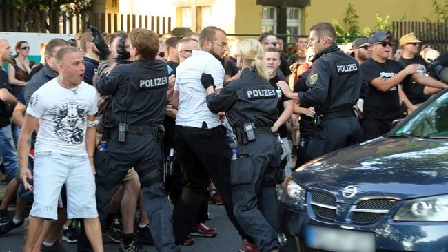 Protesters have been violently clashing with police, after a refugee 'tent city' was installed in Dresden. Photo: AFP / DPA/ Roland Halkasch.