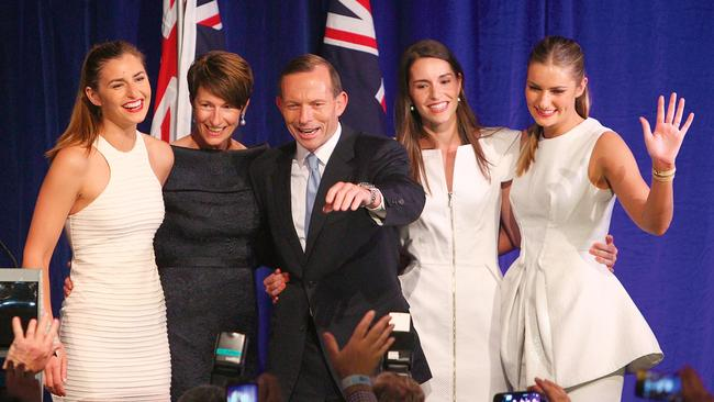 Former Prime Minister Tony Abbott and his family, from right, Bridget, Louise, wife Margaret and Frances during his victory speech after the 2013 federal election. Picture: Marianna Massey