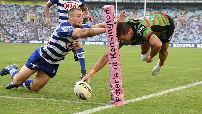 Braidon Burns of the Rabbitohs scores a try.
