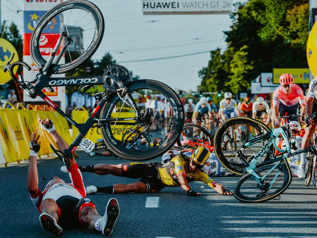 TOPSHOT - Dutch cyclist Dylan Groenewegen (on the ground ,C) and fellow riders collide during the opening stage of the Tour of Poland race in Katowice , southern Poland on August 5, 2020. - Dutch rider Fabio Jakobsen was fighting for his life on Wednesday after he was thrown into and over a barrier at 80km/h in a sickening conclusion to the opening stage of the Tour of Poland. (Photo by Szymon Gruchalski / Forum / AFP)