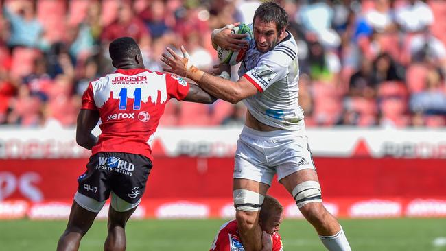 Crusaders captain Sam Whitelock is held up by the Lions defence in Johannesburg.