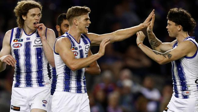 Mason Wood celebrates a goal during North Melbourne's rousing win over Western Bulldogs. Picture: Daniel Pockett/AFL Media/Getty Images.