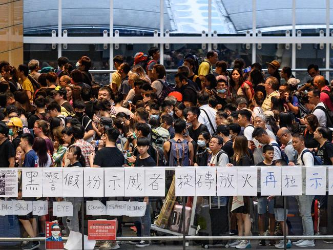 Protesters line up for a train at the airport station after a protest against police brutality and the controversial extradition bill on August 12, 2019. Picture: AFP