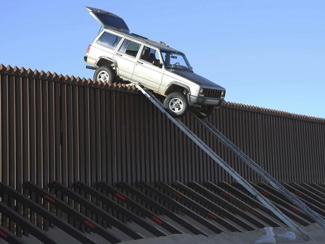 A silver Jeep Cherokee that suspected smugglers attempted to drive over the 14-foot high US-Mexico border fence in 2012. Picture: U.S. Customs and Border Protection/AP