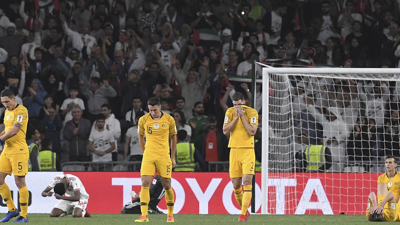 Australian players react as they're knocked out of the Asian Cup.