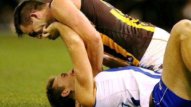Brian Lake scraps with Drew Petrie in the third quarter.