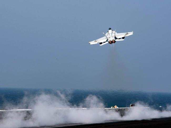 An F/A-18E Super Hornet launching from the flight deck of an aircraft carrier. Two US Navy aircraft shot down a Syrian regime plane on June 18, 2017, after it dropped bombs on US-backed forces fighting the Islamic State. Picture: US Navy