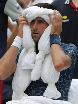 Novak Djokovic, of Serbia, uses ice towels to cool off during a changeover in his match against Marton Fucsovics, of HungaryPicture: AP Photo